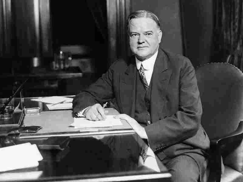 Republican Presidential candidate Herbert Hoover at his desk in his Washington headquarters, 1928. Hoover was credited with directing flood relief operations as Secretary of Commerce under President Calvin Coolidge.