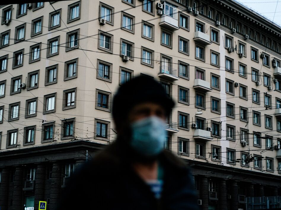 A man wearing a face mask walks in Moscow in mid-April during a strict lockdown to stop the spread of the coronavirus. (Dimitar Dilkoff/AFP via Getty Images)