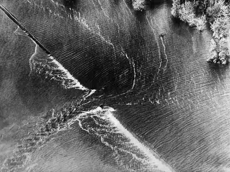 Aerial view of one of the burst dikes on the Mississippi River, April 1927.