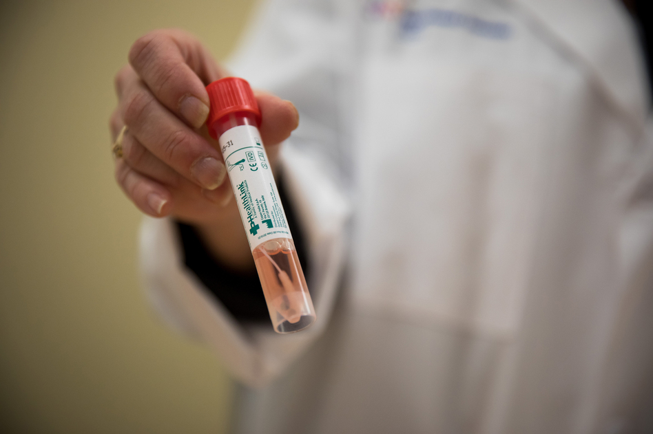 A pathologist holds a vial from a COVID-19 test kit. Various bottlenecks in the U.S. that have constrained widespread testing for the coronavirus were problems in February and persist today. (Michael Nagle/Bloomberg via Getty Images)