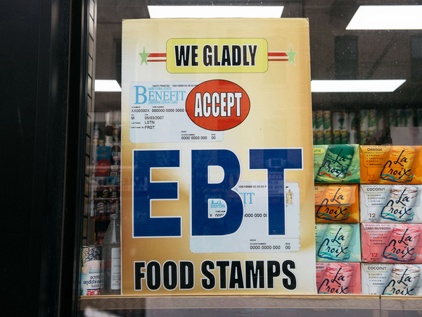 A sign alerting customers about SNAP food stamps benefits is displayed at a Brooklyn grocery store in December 2019.