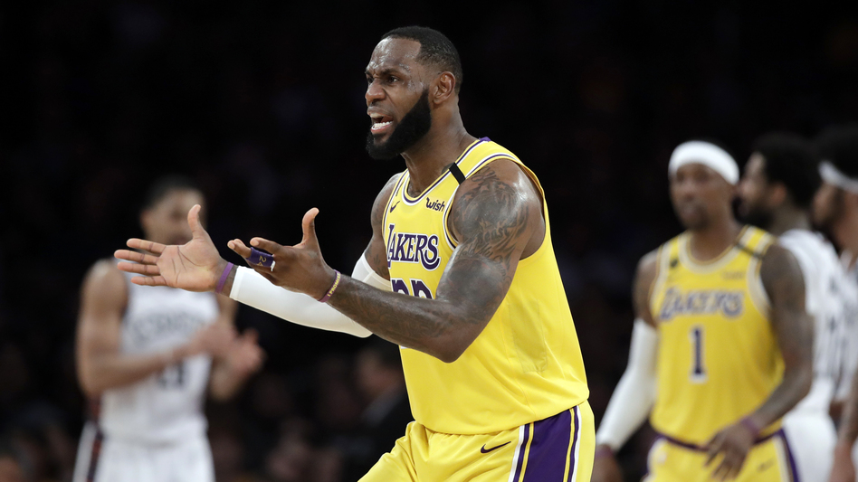 The Los Angeles Lakers and a handful of businesses are returning money they received from a federal program that was intended to help small companies hurt by the coronavirus pandemic. (Marcio Jose Sanchez/AP)