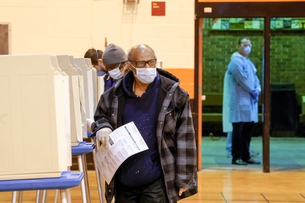 Voters in Milwaukee, Wisc. earlier this month. Eager to avoid making many voters use crowded polling places amid a pandemic, states are looking to expand absentee voting while a few are piloting internet-based voting for some voting populations.