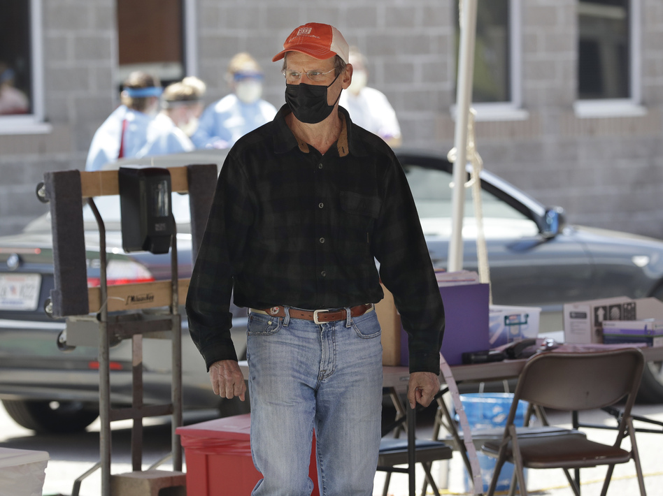 Tennessee Gov. Bill Lee visits a drive-through COVID-19 testing location on April 18 in Franklin, Tenn. (Mark Humphrey/AP)