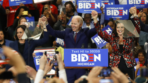 Sen. Kamala Harris, D-Calif., and Michigan Gov. Gretchen Whitmer, seen campaigning with former Vice President Joe Biden in March, are two of the women often talked about as possible running mates on the Democratic ticket.