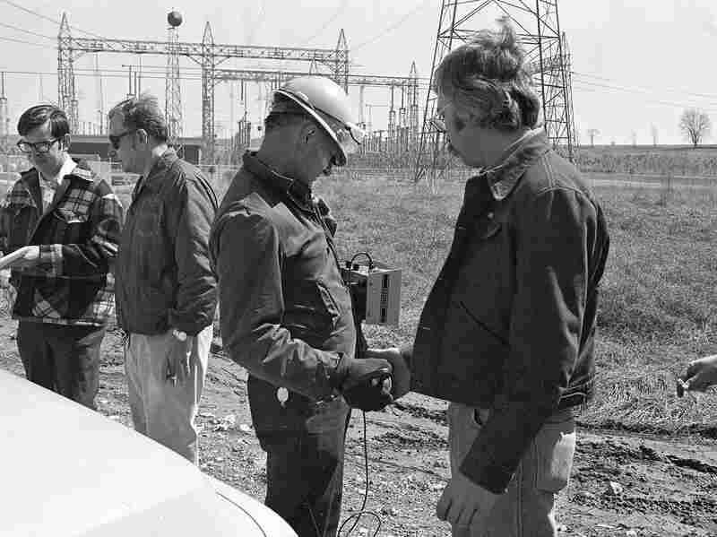 A safety official checks a worker from the Three Mile Island nuclear power plant for possible exposure to radioactivity, on March 28, 1979, in Middletown, Pa., shortly after an accident at the nuclear power plant led to the release of radioactive gas from the reactor into the atmosphere.