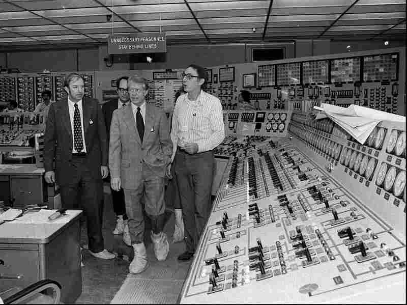 President Carter, center right, accompanied by Dr. Harold Denton, Director of the U.S. Nuclear Agency, left, and Pennsylvania Gov. Dick Thornburgh, left-rear, tour the control room of the Three Mile Island nuclear plant in Middletown, Pa. on April 1, 1979, four days after the nuclear accident.