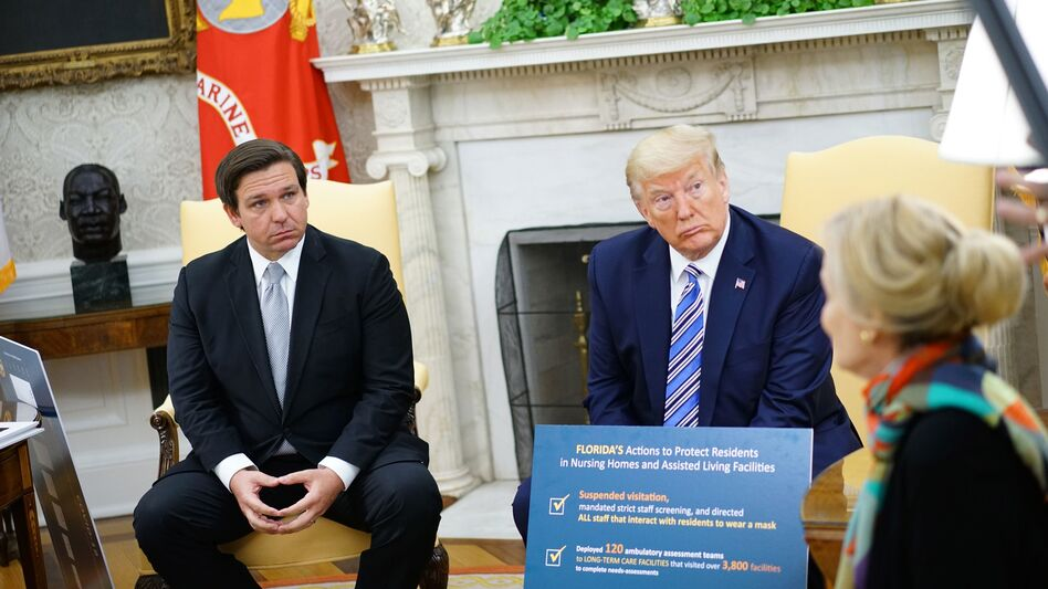 Gov. Ron DeSantis, pictured during a meeting with President Trump on Tuesday, has announced plans to reopen businesses in Florida. (Mandel Ngan/AFP via Getty Images)