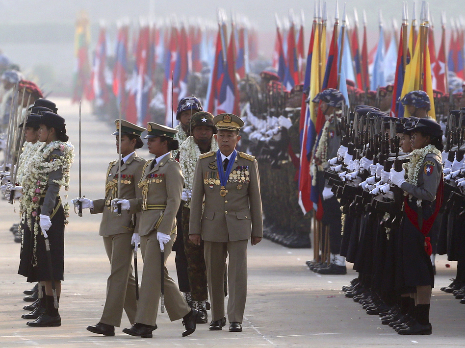 Myanmar military deputy Commander in Chief, Vice Senior Gen. Soe Win, center, inspects military officers on Armed Forces Day last year. A U.N. human rights monitor is accusing the military of war crimes and crimes against humanity. (Aung Shine Oo/AP)