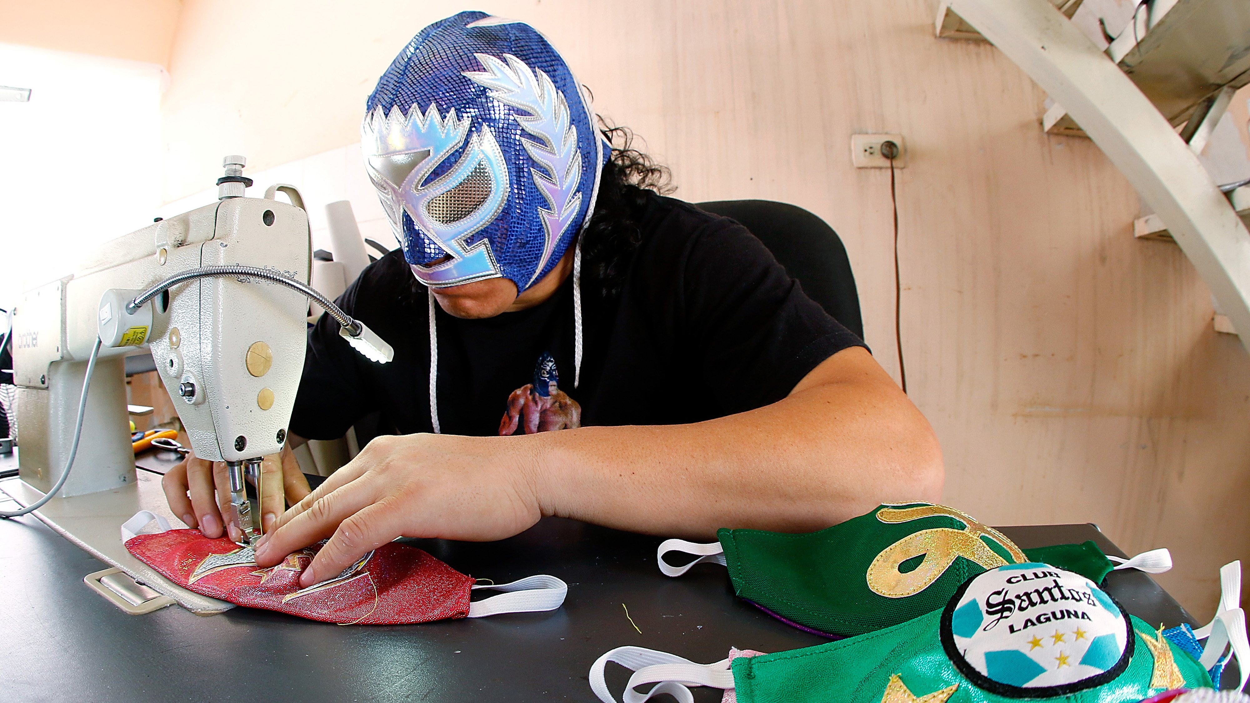 A Mexican Lucha Libre Wrestler Is Sewing Masks To Fight