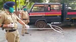 How To Nab Suspects While Social Distancing? Indian Police Try Giant Tongs