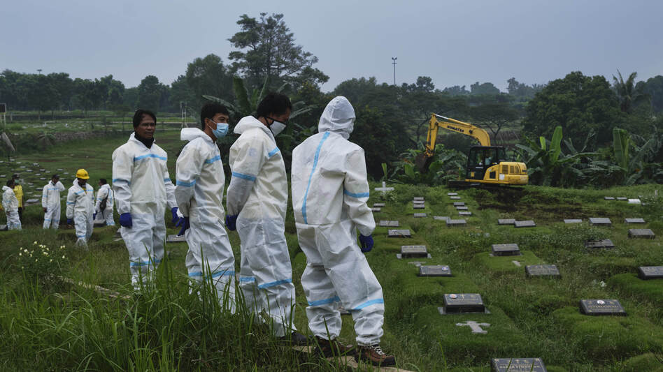 A new section of a municipal cemetery in Jakarta is expanded for graves of those suspected of dying from COVID-19. (Ed Wray/Getty Images)