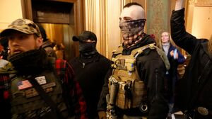 Protesters Swarm Michigan Capitol Amid Showdown Over Governor's Emergency Powers
