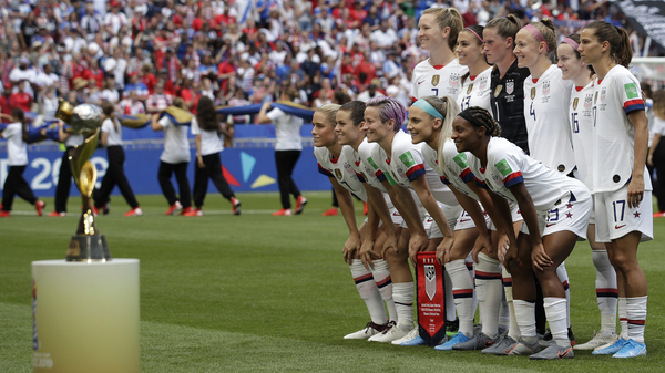 Players line up for a photo prior to the Women's World Cup final between the U.S. and The Netherlands in Décines, outside Lyon, France, on July 7, 2019. The U.S. team would go on to win 2-0 and claim its fourth World Cup title.