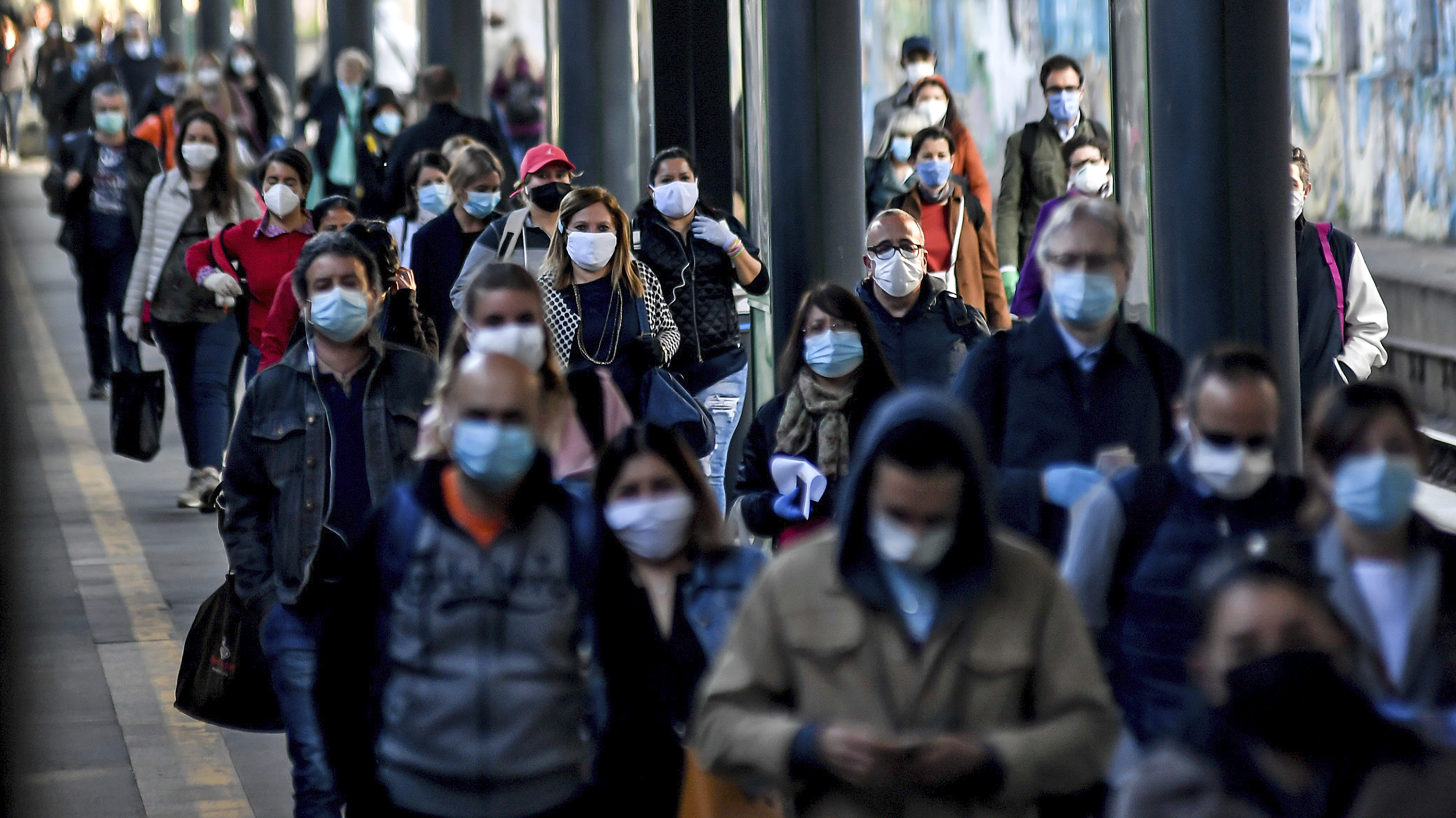 Commuters crowd Cadorna train station in Milan on Monday. Italy has begun stirring again, after a nearly two-month coronavirus shutdown, as restrictions on movement ease.