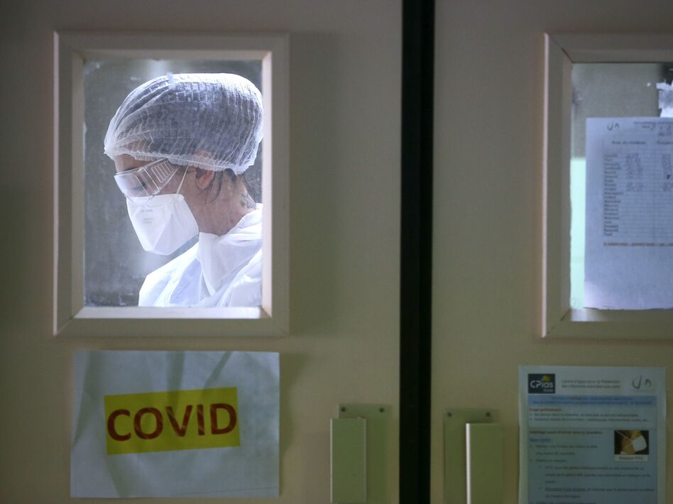 A nurse in the Eugenie Hospital in Ajaccio, on the French Mediterranean island of Corsica, on April 23. France appears to have had its first case of COVID-19 in December, a month earlier than doctors thought. (Pascal Pochard-Casabianca/AFP via Getty Images)