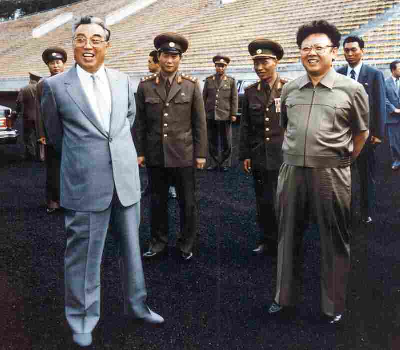 North Korean leader Kim Il-Sung (left) with his son Kim Jong-Il (right), inspecting soccer grounds in Pyongyang.