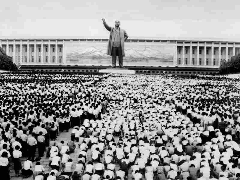 """On July 9, 1994, thousands of people gather in front the Korean Revolution Museum in Pyongyang to mourn the death of Kim Il-sung. After his death Kim Il-sung was named """"eternal president"""" of the Democratic People's Republic of Korea."""