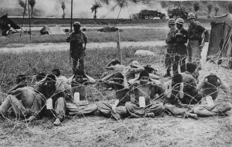American troops capture North Korean prisoners as U.S. forces retreat from Yongsan in Seoul.