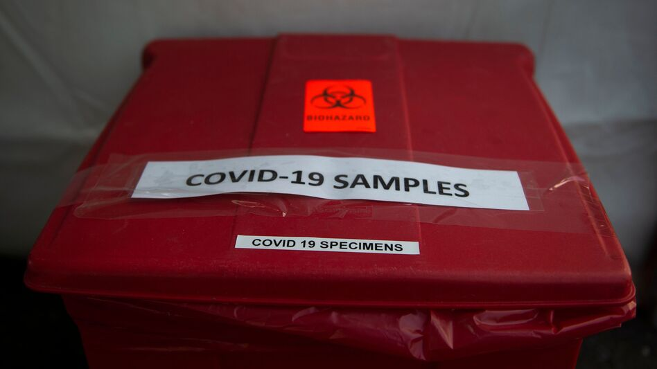 A bucket used to collect samples after people have been tested for COVID-19 is seen at a drive through testing site in Arlington, Va., on March 20. One group in northern Virginia is paying special attention to the coronavirus's impact on Latinos. (Andrew Caballero-Reynolds/AFP via Getty Images)