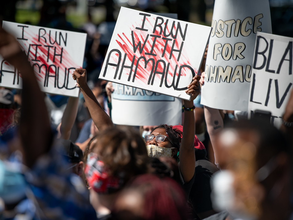 Demonstrators protest the shooting death of Ahmaud Arbery at the Glynn County Courthouse on May 8 in Brunswick, Ga. (Sean Rayford/Getty Images)