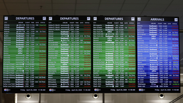 An airline arrival and departure board shows several canceled flights last month at the Tampa International Airport in Florida.