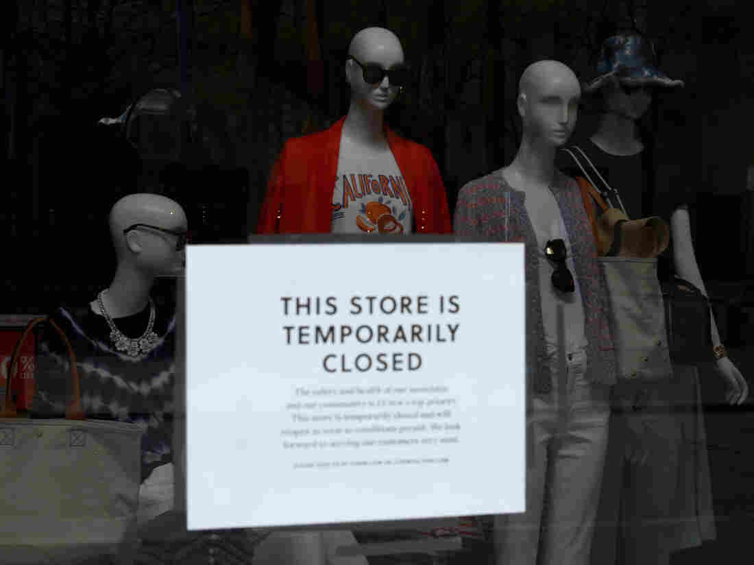 A sign is seen at the window of a closed J.Crew store near Rockefeller Plaza on May 4, 2020 in New York City. - US clothing retailer J. Crew filed to begin bankruptcy protection proceedings Monday, after reaching an agreement with major creditors on a $1.65 billion debt restructuring plan, the company said in a statement. (Photo by ANGELA WEISS/AFP via Getty Images)