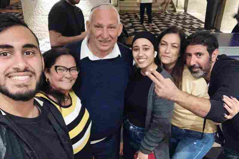 Amram and Gina Maman (second and third from left) with Aysha Abu Shhab (fourth from left) and other hotel patients.