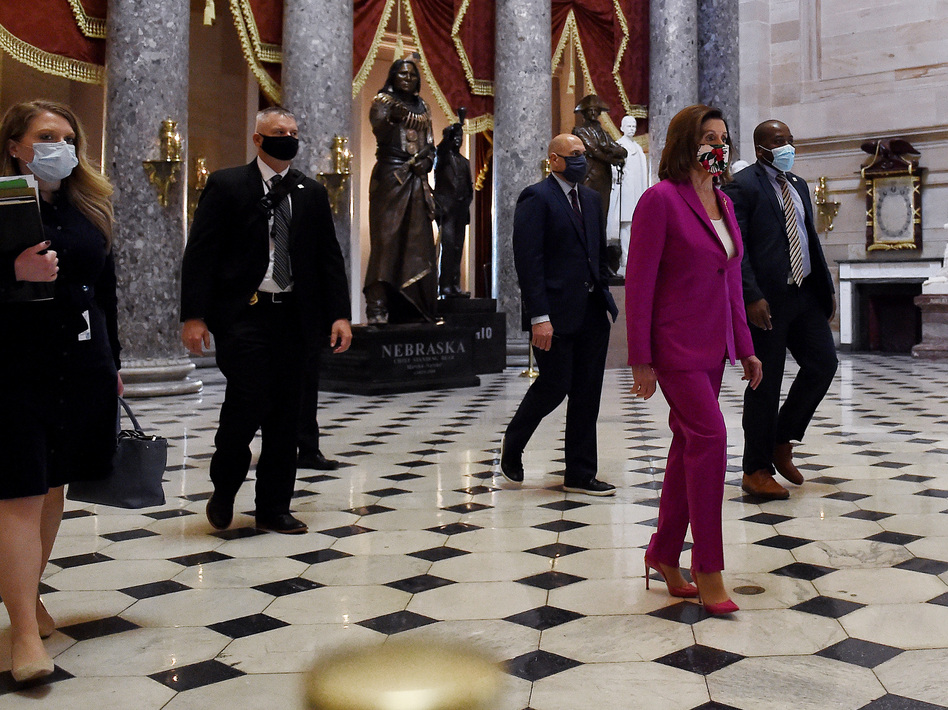 House Speaker Nancy Pelosi, D-Calif., walks past the Statuary Hall ahead of floor debate on a record $3 trillion coronavirus response package Friday to fund the fight against the pandemic and provide emergency payments to millions of Americans. (Olivier Douliery/AFP via Getty Images)