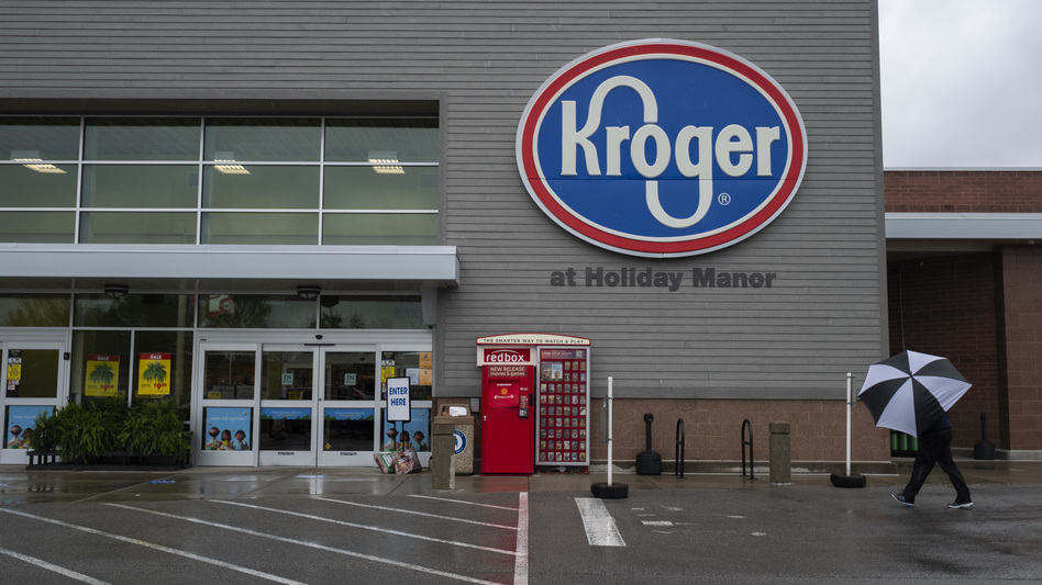 "The increase in cases comes after companies such as Kroger ended extra ""hero pay"" for their workers. (Bloomberg via Getty Images)"