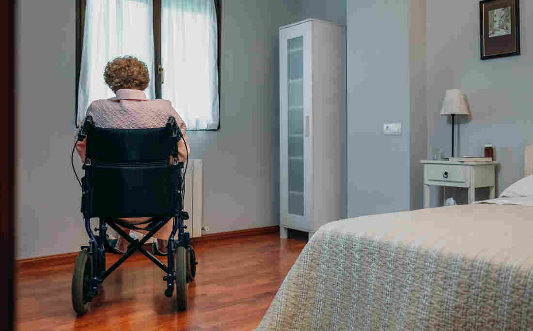 Senior patient sitting in a wheelchair.