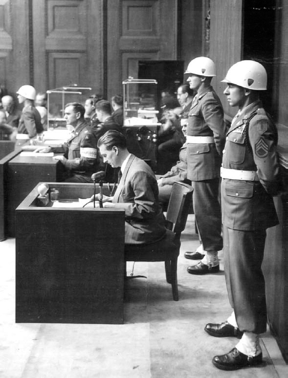 Staff Sgt. Emilio DiPalma (right) stands on guard at the Nuremberg Trials in 1945. (Courtesy Emily Aho)