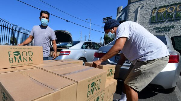 People load their vehicles with boxes of food at a Los Angeles Regional Food Bank earlier this month in Los Angeles. Food banks across the United States are seeing numbers and people they have never seen before amid unprecedented unemployment from the COVID-19 outbreak.