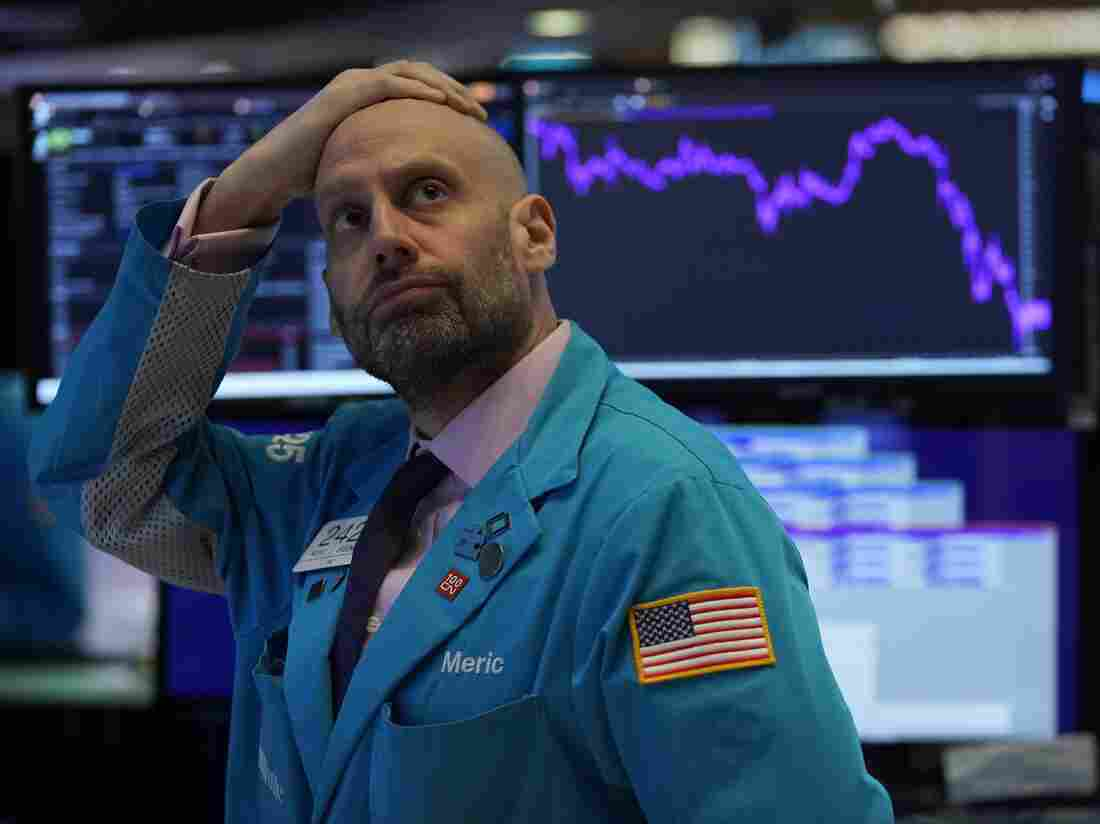 Meric Greenbaum, Designated Market Maker IMC financial looks up at the board before the opening bell right before trading halted on the New York Stock Exchange on March 9, 2020 in New York. (Photo by TIMOTHY A. CLARY/AFP via Getty Images)