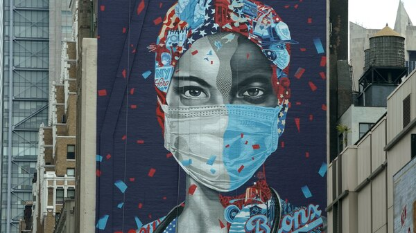 A mural honoring health care workers at Montefiore Medical Center in the Bronx is seen on the side of a building in Midtown Manhattan on May 11 in New York.