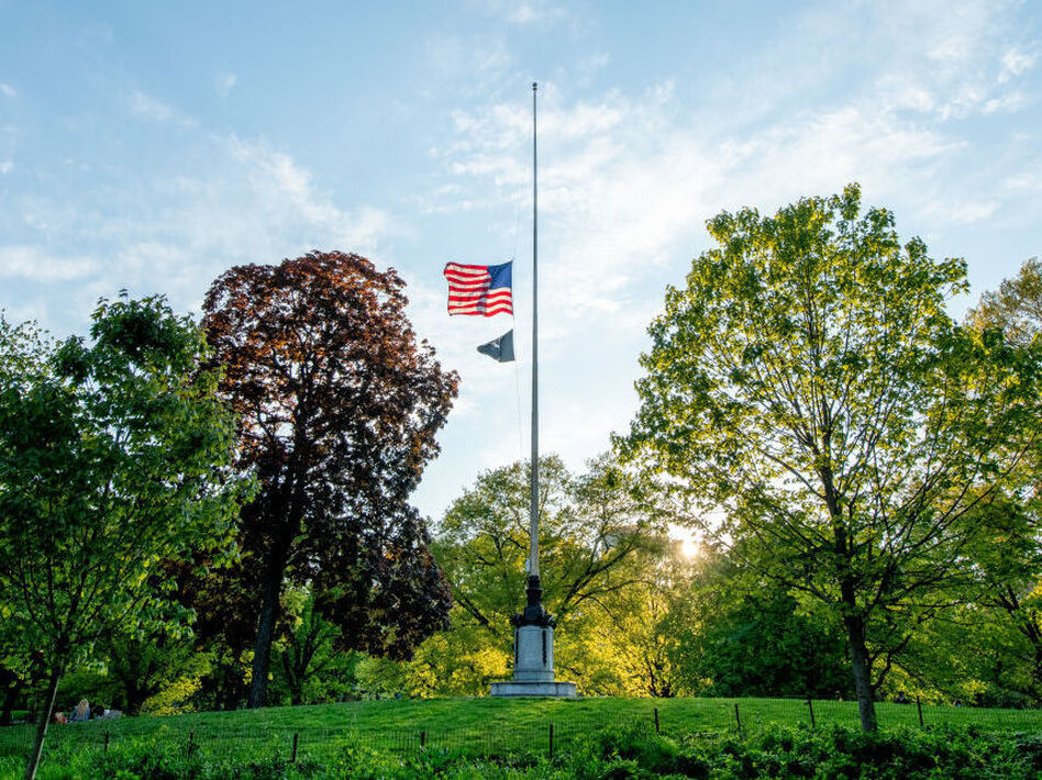 U.S. flags will fly at half-staff on federal and military posts through Sunday as President Trump orders a remembrance of the nearly 100,000 people who have died from COVID-19 in the U.S. Earlier this month, flags in the hard-hit state of New York flew at half their normal height to honor those lost to the pandemic. (Roy Rochlin/Getty Images)