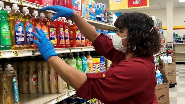 Yesenia Ortiz works at a grocery store in Greensboro, N.C. She says she wishes she would get paid more during the pandemic because of the extra level of risk to which she is exposed.