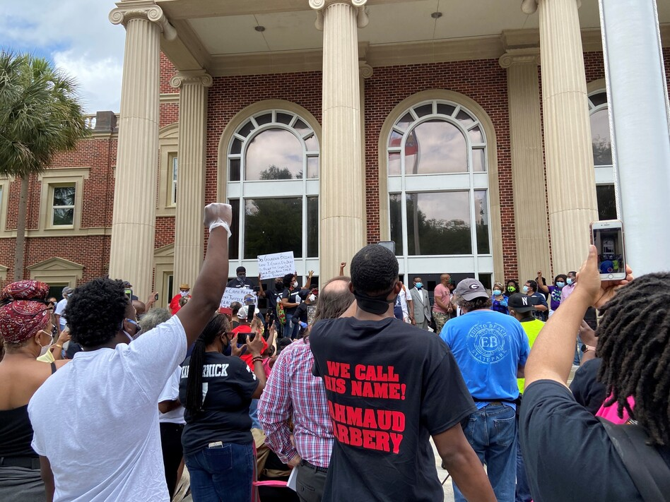 Hundreds of people gathered in front of the Glynn County Courthouse on a recent Saturday in May to demand justice for Ahmaud Arbery, who was shot and killed in February in Brunswick, Ga. (Emma Hurt/WABE)