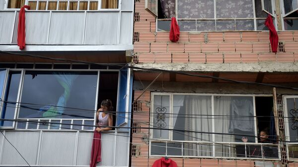 Residents of the Colombian capital Bogotá hang red rags from their windows and balconies to signal their need for help with food during the coronavirus pandemic.