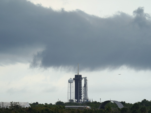 Clouds pass over the SpaceX Falcon 9, with the Crew Dragon spacecraft on top of the rocket, as it sits on Launch Pad 39-A on Wednesday at Kennedy Space Center in Cape Canaveral, Fla.