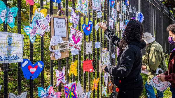 A volunteer artist sets up a memorial in Brooklyn on May 20. Artists and volunteer organizers across New York City put up physical memorials throughout the five boroughs in connection with Naming the Lost to honor the lives lost to COVID-19.