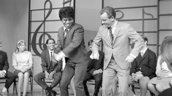 James Brown performs at KCOP Studios on the Lloyd Thaxton Show with Lloyd Thaxton in 1964. Brown helped popularize boogaloo-style dancing, shown here.