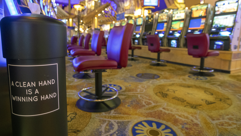A hand sanitizing wipe station is seen next to the slot machines at the Mohegan Sun casino on May 21. Connecticut's two federally recognized tribes said they're planning to reopen parts of their casinos on June 1, despite Gov. Ned Lamont saying it's too early and dangerous. (Mary Altaffer/AP)