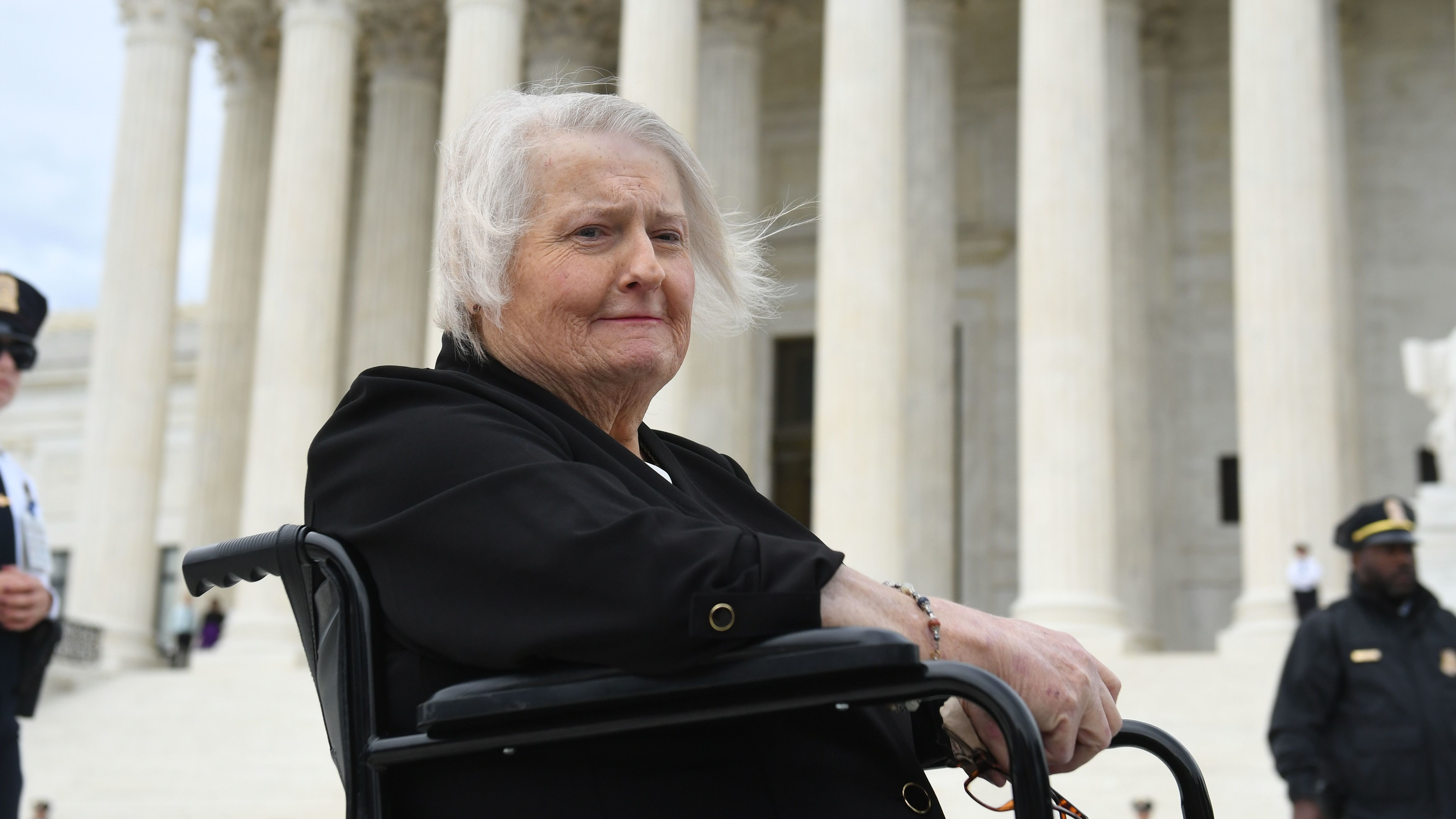 Transgender activist Aimee Stephens sits outside the Supreme Court on Oct. 8 as the court holds oral arguments in cases dealing with workplace discrimination based on sexual orientation.