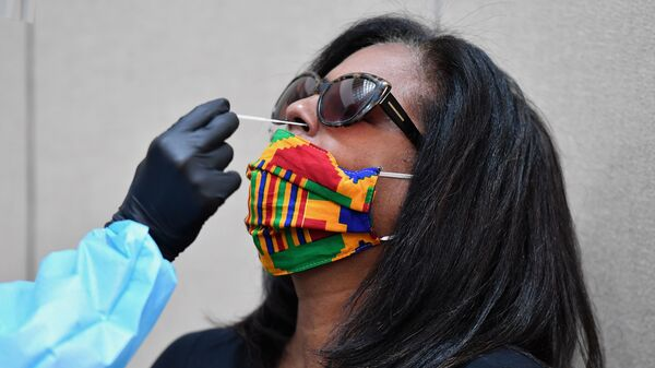 A woman is tested for the coronavirus at Harlem