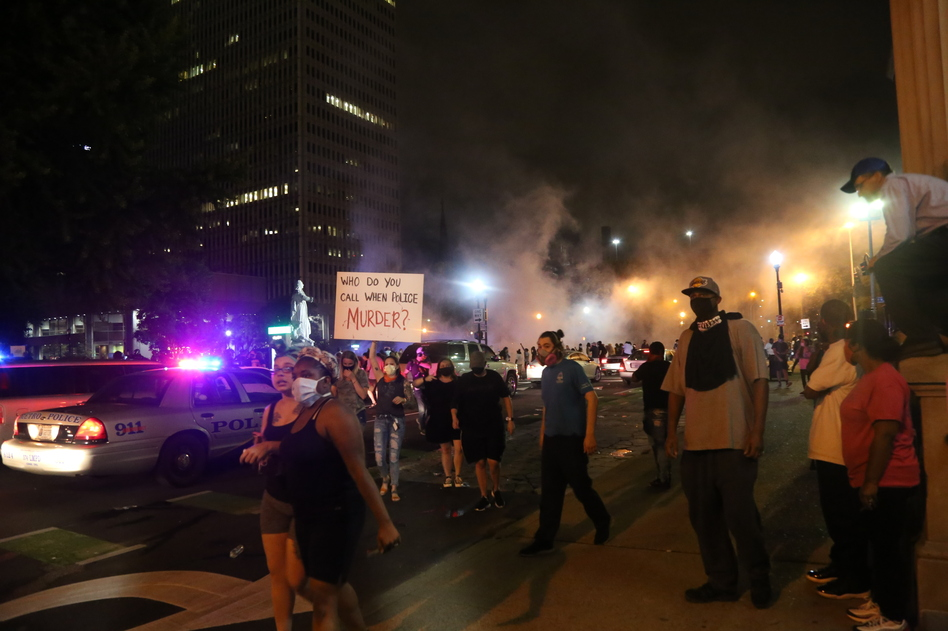 Police attempt to break up the protest with tear gas and rubber bullets minutes after shots are fired into the crowd in Louisville, Ky. (Ryan Van Velzer / WFPL)