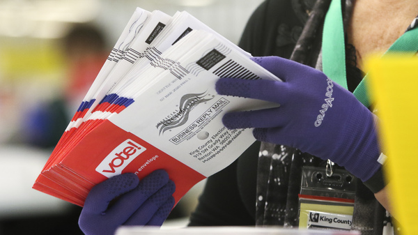 An election worker sorts vote-by-mail ballots for the presidential primary in Washington on March 10.