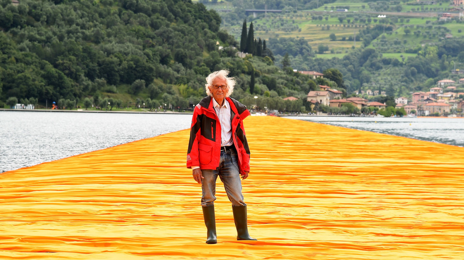 Artist Christo Vladimirov Javacheff attends the presentation of his installation <em>The Floating Piers</em> on June 16, 2016, in Sulzano, Italy. He died Sunday at age 84. (Pier Marco Tacca/Getty Images)