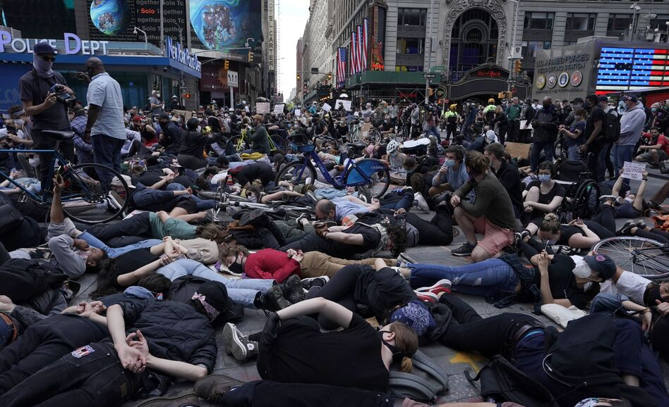 Protesters lie on the ground with their hands behind their backs in New York City's Times Square on Monday. Outrage over police brutality and systemic racism has spilled into the streets in cities across the country. (Timothy A. Clary/AFP via Getty Images)