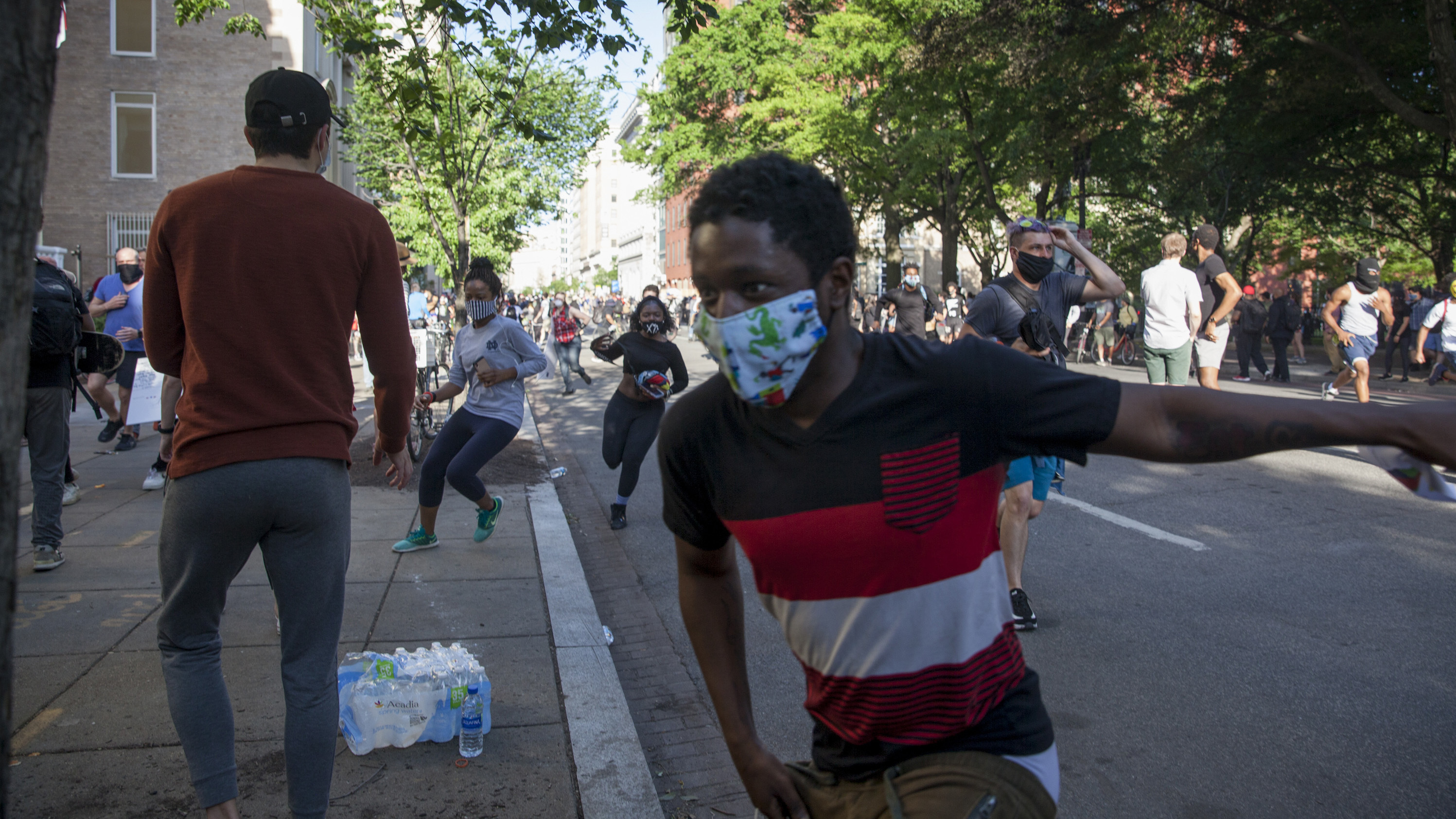 Protesters and police clash near Lafayette Park late Monday in downtown Washington, D.C.